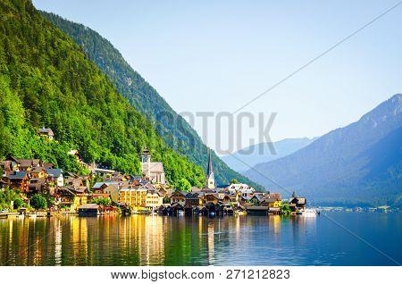 Famous Hallstatt Village At Rays Of Morning Sun