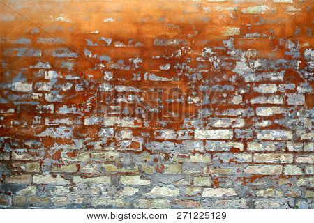 Detial Of An Old Brick Wall With Ocre Tones