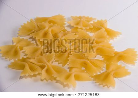 Pasta In The Form Of Bows On A White Background