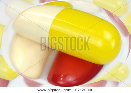 Medicine capsules are encased in a transparent shell. Some medicines are timebombs waiting to explode on unsuspecting patients with harmful side effects. poster