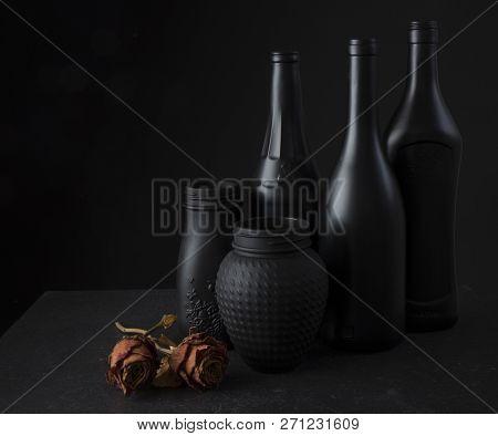 Still Of Black Bottles And 3 Roses