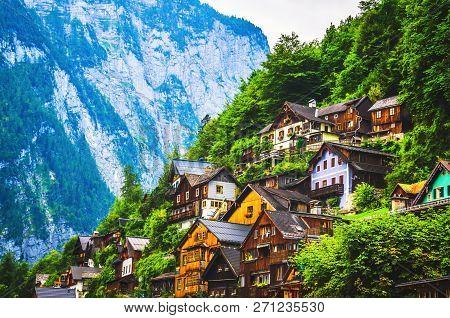 Typical Austrian Houses Standing On The Mountain Hillside In Alps. Hallstatt, Austria