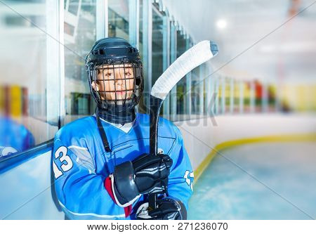Young Ice Hockey Player In Protective Equipment