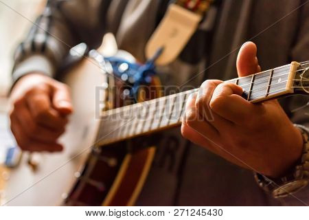 Close Up Hands Of Man Playing Banjo
