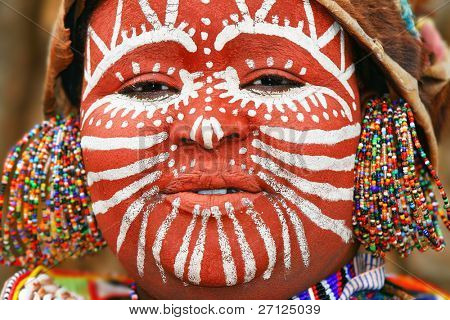 AFRICA, KENYA, NAKURU - NOVEMBER 9:Portrait of a Kenyan warrior with traditionally painted face,review of daily life of local people, near to Lake Nakuru National Park Reserve, November 9, 2008, Kenya