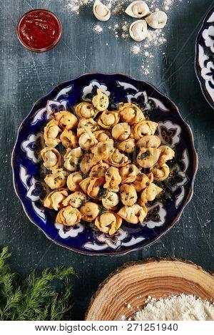 Oriental Fried Dumplings with Minced Meat also known as Gyoza, Dim Sum, Jiaozi, Momo, Tortellini, Pierogi, Varenyky, Mandu or Ravioli Top View. Hot Crunchy Deep-Fried Beef and Mutton Pelmeni