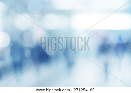Abstract Defocused Blurred Empty Space Technology Background With Silhouettes Of Unrecognizable Peop