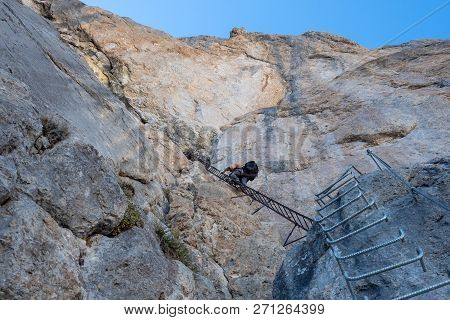 Male Mountain Climber On A Via Ferrata Of Dolomites Mountains In Italy. Travel Adventure Concept, Do