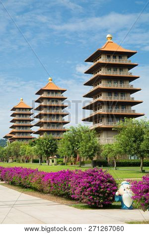Pagodas each representing different ideas or precepts with purple flowers