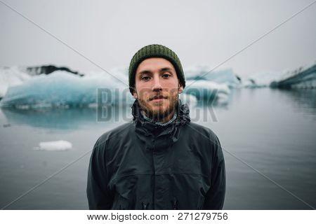 Portrait Of Handsome Rough Serious Millennial Man