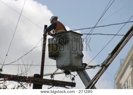 Electrical Worker On A Lift