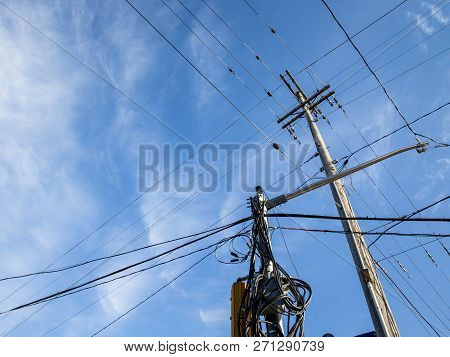 Electric Power Line, Old And Outdated, On A Rotten Wooden Pole, Abiding By North American Standards,