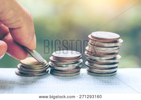 Business And Money Saving Concept - Close Up Of Man Hand Putting Euro Coins Into Columns, Coins Stac