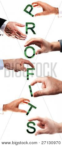 Profits word made by many business people hands