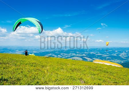 Skydiving Training In Mountains,  Flying Above The Distant Hills. Parachute Extreme Sport.   Absolut