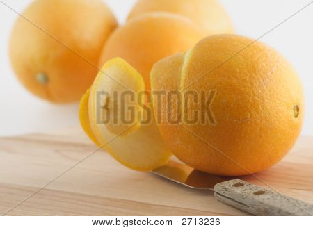 Peeled Orange And Knife