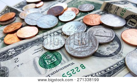 Close Up American Quarter, Dime And Penny Coins On Two Dollars Usa Background