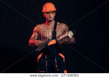 Our Reputation Is As Solid As Concrete. Muscular Man Does Masonry Work. Bricklayer Worker. Construct