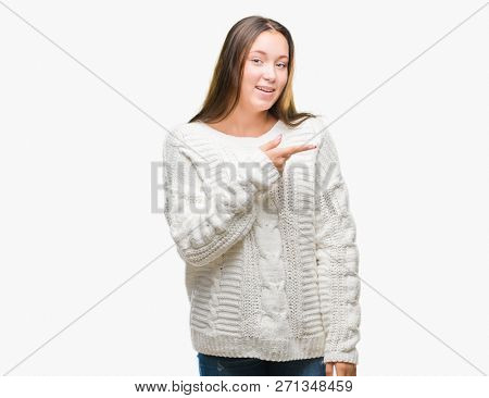 Young beautiful caucasian woman wearing winter sweater over isolated background cheerful with a smile of face pointing with hand and finger up to the side with happy and natural expression on face