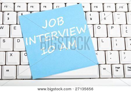 Job interview mesage on keyboard
