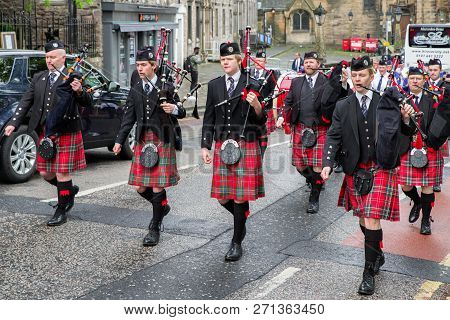 Edinburgh, Scotland - May 20: Ceremonial March Of Orchestra With Bagpipes And Kilts On  May 20, 2018