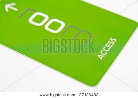 green access card on white background - close-up