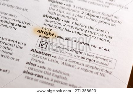 The Word Or Phrase Alright In A Dictionary Highlighted With Marker.