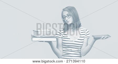 Contemporary Education Concept. Girl Student Holding Traditional Textbook And Ebook Reader On Backgr