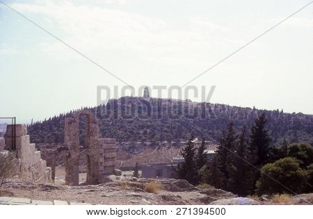 Philopappos Hill And Ancient Monument Ruins Viewed From The Acropolis, In Athens Greece. Vintage Pho