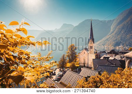 Classic Postcard View Of Famous Hallstatt Lakeside Town In The Alps With Historic Church Tower In Sc