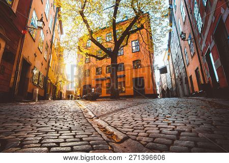Charming Stockholm Street Scene With Old Colorful Houses In Beautiful Golden Evening Light At Sunset