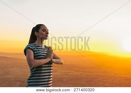 A Girl Practices Yoga Or Meditation Or Searching For A Soul Against The Backdrop Of A Beautiful Suns