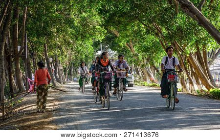 Taunggyi, Myanmar - Feb 8, 2018. Women Biking On Street In Taunggyi, Myanmar. Since 1962, Myanmar Ha