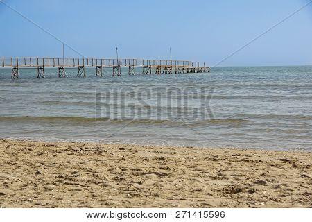 Pier Walk By The Sea . Pedestrian Pier In The Sea For Mooring Boats