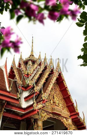 Architectural detail from exterior view of the Buddhist temple in Damnoen Saduak Floating Market near Bangkok, Thailand