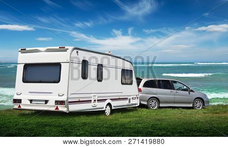 Russia. Yeisk district. The Sea of Azov 05/02/2018  The caravan stands on the Vedic lawn by the sea. The family went on vacation to nature.