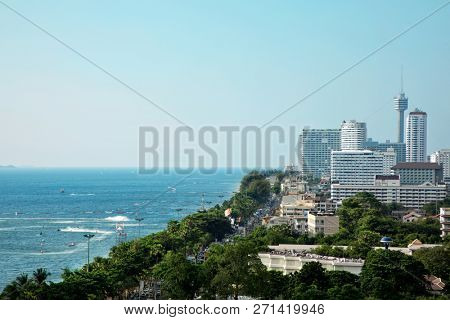 Elevated view cityscape of modern architecture buildings over blue clear sky in downtown Pattaya, Thailand