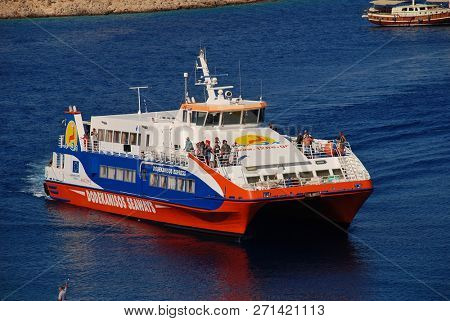 HALKI, GREECE - JULY 14, 2016: Dodekanisos Seaways catamaran ferry Dodekanisos Express arrives at Emborio harbour on the Greek island of Halki. The 40mtr vessel was built  in Norway in 2000.