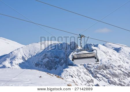 a ski chairlift in alpine resort