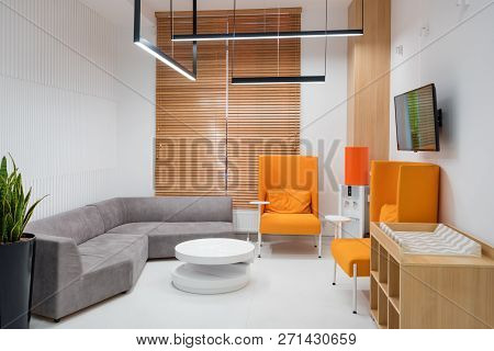 Interior Of A Modern Hospital Waiting Room. Clinical With Empty Chairs. Brand New And Empty European