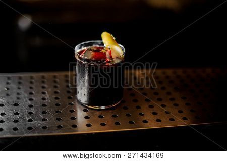 Cocktail Glass With Strong Dark Bittersweet Cocktail