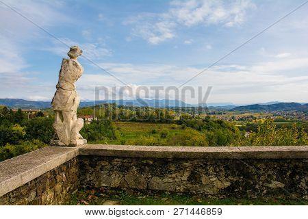 The autumn landscape in the Collio vineyard area of Friuli Venezia Giulia, north west Italy, showing a statue from the historic Abbazia di Rosazzo Abbey poster