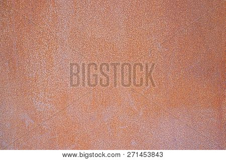 Red Metal Texture With Scratches And Cracks. Weathered Steel Textur. Close-up Rusty Metal Sheet Back