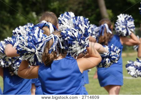 Cheerleaders Cheering During Football Game