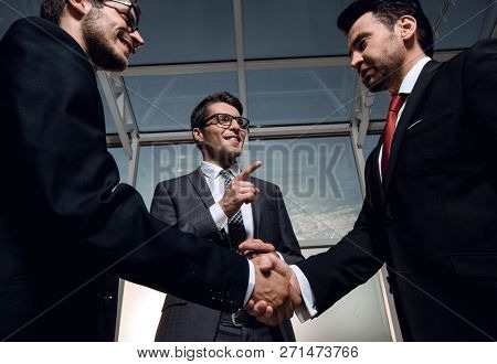 welcome and handshake of business people