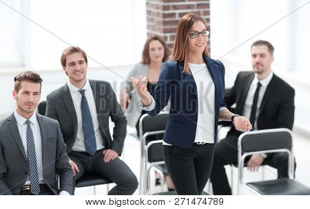 busines woman at business seminar takes a question