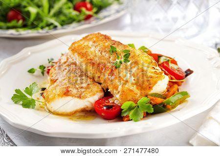 Fresh Backed Codfish Filet On White Table.