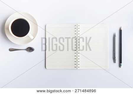 Top View Of An Desk Office Table. White Office Desk Top With Cup Of Coffee. Working On Desk And Offi