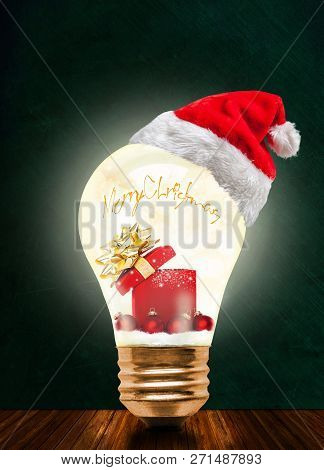 Glowing Light Bulb Wearing Santa Hat With Merry Christmas Message And Magical Gift Box And Baubles W