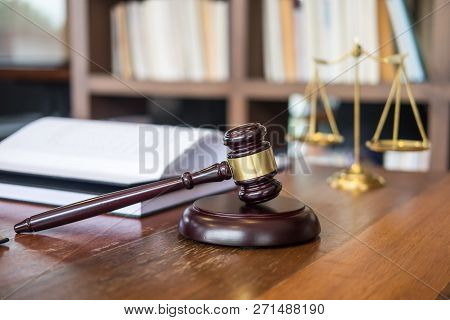 Wooden Judges Gavel On Wooden Table On Light Background, Justice Law Concept Close Up In A Courtroom